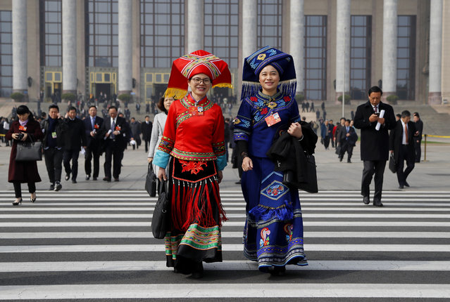 Delegates dressed in ethnic wear leave after attending a a plenary session of China's National People's Congress (NPC) at the Great Hall of People in Beijing, Tuesday, March 13, 2018. Chinese President Xi Jinping's anti-corruption campaign stands to gain a major boost as the ceremonial legislature moves to establish a powerful new agency with authority over vast numbers of workers in the public sector. (Photo by Aijaz Rahi/AP Photo)