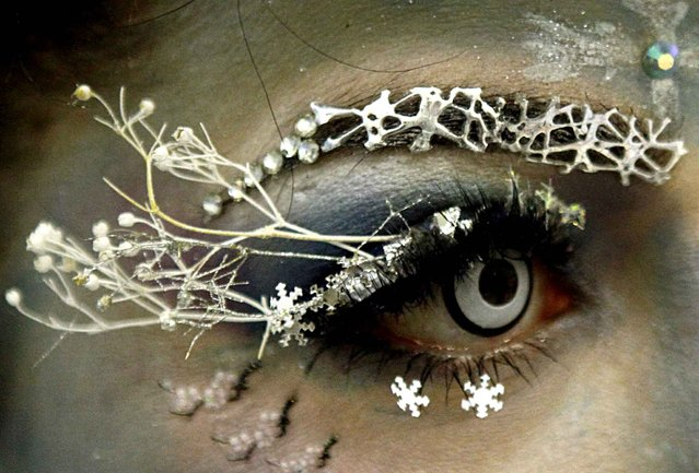 A participant takes part in the first Belarussian eyelash extension Beauty Eyes championship in Minsk on December 7, 2014. (Photo by Sergei Gapon/AFP Photo)