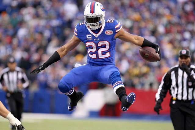 December 14, 2014 file photo; Orchard Park, NY, USA; Buffalo Bills running back Fred Jackson (22) jumps to avoid a tackle during the second half against the Green Bay Packers at Ralph Wilson Stadium. Buffalo beat Green Bay 21-13. (Photo by Timothy T. Ludwig/Reuters/USA TODAY Sports)