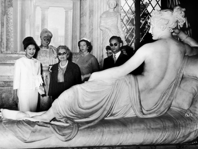 King Bhumibol and Queen Sirikit before a statue of Paolina Borghese shown in Borghese Museum in Rome, 1960. (Photo by Keystone-France/Gamma-Keystone via Getty Images)