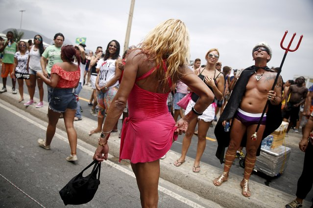 Revellers take part in LGBT Pride Parade in Copacabana beach in Rio de Janeiro, Brazil, November 15, 2015. (Photo by Pilar Olivares/Reuters)
