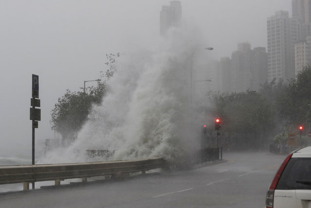 Waves crash on waterfront caused by Typhoon Haima in Hong Kong, Friday, October 21, 2016. (Photo by Kin Cheung/AP Photo)