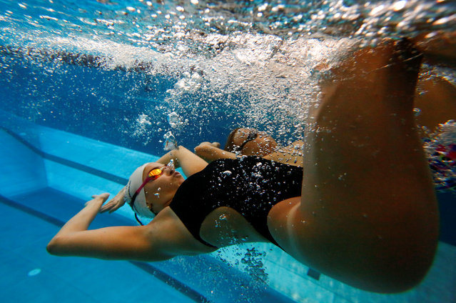 Syrian refugee and Olympic swimmer Yusra Mardini is pictured during a training session in a pool at the Olympic park in Berlin, Germany on April 26, 2018. (Photo by Fabrizio Bensch/Reuters)