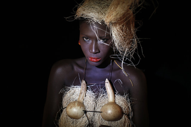 Senegalese model Dji Dieng poses for a portrait backstage during Dakar Fashion Week July 10, 2011. (Photo by Finbarr O'Reilly/Reuters)