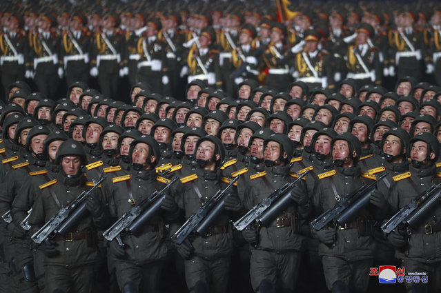 In this photo provided by the North Korean government, North Korean soldiers march in formation during a military parade marking the ruling party congress, at Kim Il Sung Square in Pyongyang, North Korea Thursday, January 14, 2021. (Photo by Korean Central News Agency/Korea News Service via AP Photo)
