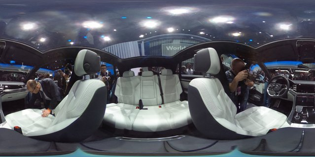 Journalists photograph the interior of Volkswagen's  new Cross Coupe GTI SUV that will come out in 2016 at North American International Auto Show on Monday, January 12, 2015 in Detroit. This is a Theta 360 photo. (Photo by Julian H. Gonzalez/Detroit Free Press/TNS)