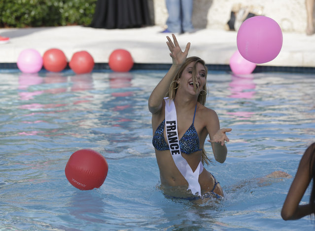 Miss Universe contestant  Camille Cerf, of France, tosses a beach ball during the  Yamamay swimsuit runway show, Wednesday, January 14, 2015, in Doral, Fla. (Photo by Lynne Sladky/AP Photo)