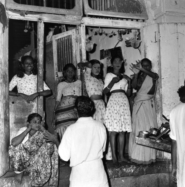 6th December 1964:  Indian prostitutes stand in a doorway.  (Photo by Terry Fincher/Express/Getty Images)