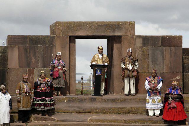 Bolivia's President Evo Morales (C) speaks during a ceremony at the Tiahuanaco ruins some 70 km from La Paz, January 21, 2015. (Photo by David Mercado/Reuters)
