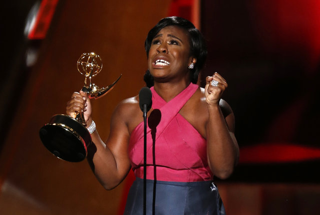 """Uzo Aduba accepts the award for Outstanding Supporting Actress In A Drama Series for her role in Netflix's """"Orange is the New Black"""" at the 67th Primetime Emmy Awards in Los Angeles, September 20, 2015. (Photo by Lucy Nicholson/Reuters)"""