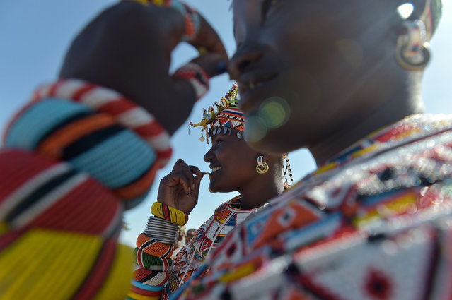 Samburu women of the Lorubai traditional dance group are seen wearing traditional beaded necklaces during a Peace Marathon for pastoralist communities at the Archers post in Isiolo, Kenya on April 26, 2018. The aim of the event is to bring the warring pastoralist communities of Samburu, Turkana, Borana and others together, and end the rivalry due to scarcity of pasture and water in the region. The peace marathon is organized by Kenya's Northern Rangeland Trust. (Photo by Simon Maina/AFP Photo)