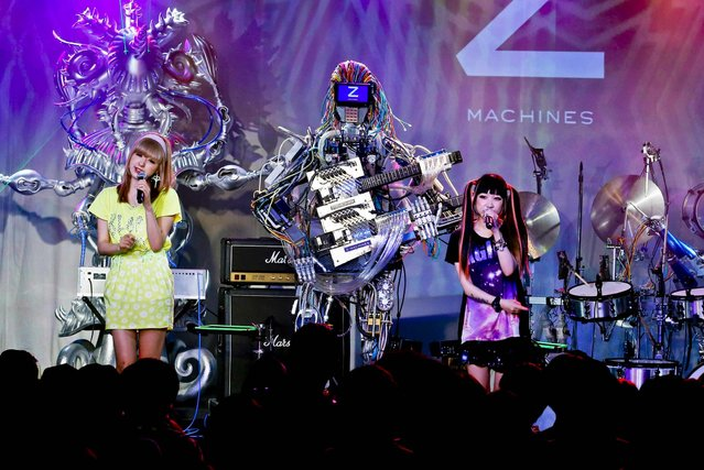 Robot music band Z-Machine perform during their first live event in Tokyo, on June 24, 2013. Supervised by Japanese artists and creators, Z-Machines has been developed to realize the cutting edge party scene by featuring the guitarist robot with 78 fingers and 12 picks, the keyboard robot that can flash multi-layered beams from its eyes and the drummer robot with 21 sticks, enabling transcendental music performance. (Photo by Koji Sasahara/Associated Press)