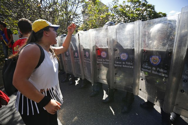 An opposition demonstrator shouts slogans at police officers during a protest in Caracas January 24, 2015. (Photo by Jorge Silva/Reuters)