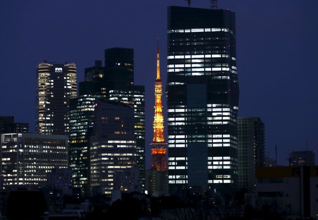 An illuminated Tokyo Tower (C) is seen between skyscrapers in Tokyo, Japan, March 10, 2016. (Photo by Issei Kato/Reuters)