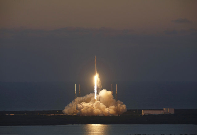 The unmanned Falcon 9 rocket, launched by SpaceX and carrying NOAA's Deep Space Climate Observatory Satellite, lifts off from launch pad 40 at the Cape Canaveral Air Force Station in Cape Canaveral, Florida February 11, 2015. (Photo by Michael Berrigan/Reuters)