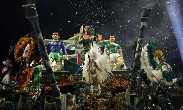 Revellers from the Mancha Verde Samba School take part in a carnival at Anhembi Sambadrome in Sao Paulo February 14, 2015. (Photo by Nacho Doce/Reuters)