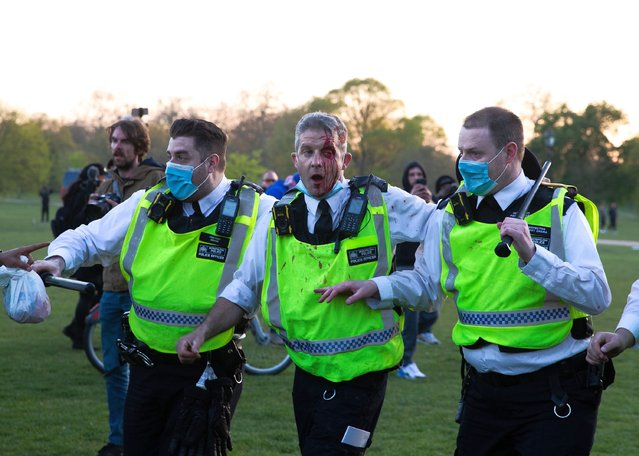Protesters clash with police at Speakers Corner as thousands attend Unite For Freedom Against COVID-19 passports and vaccines in London, UK on April 24, 2021. People called online to a flash mob-style mass gathering against vaccine passport, face masks and lockdown. The government aims to provide official proof of vaccination for millions of British holidaymakers this summer starting as early as 17 May. (Photo by World Entertainment News Network)