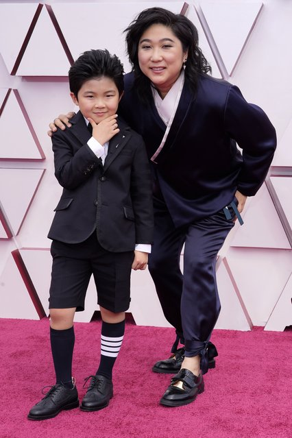 Alan S. Kim, left, and Christina Oh arrive at the Oscars on Sunday, April 25, 2021, at Union Station in Los Angeles. (Photo by Chris Pizzello/Pool via AP Photo)
