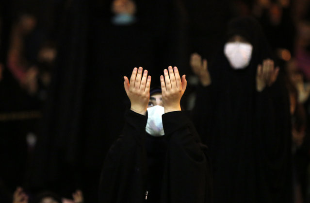 An Iranian girl prays during a religious ceremony called Laylat al-Qadr during the holy fasting month of Ramadan, outside  the Sadegh mosque in Tehran, Iran, 03 May 2021. Laylat al-Qadr (Arabic for Night of Destiny) is believed to be the night when the first verse of Islam's holy book, the Koran, was revealed to Prophet Muhammad, the exact date is not known but it is believed to be on an odd night of the last 10 nights of the holy month of Ramadan. (Photo by Abedin Taherkenareh/EPA/EFE)