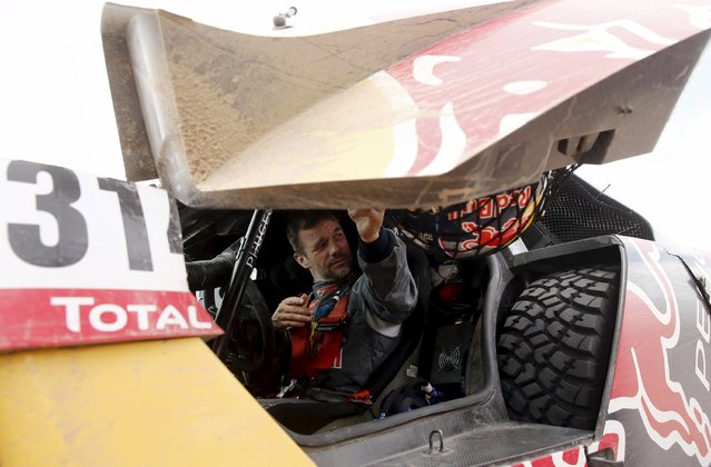 Sebastien Loeb of France closes the door of his Peugeot at the end of the 10th stage of the Dakar Rally 2016 near Fiambala, Argentina, January 13, 2016. (Photo by Marcos Brindicci/Reuters)
