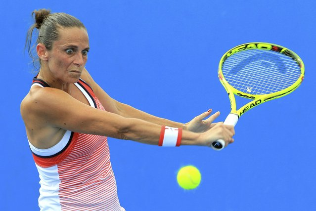 Italy's Roberta Vinci hits a shot during her first round match against Austria's Tamira Paszek at the Australian Open tennis tournament at Melbourne Park, Australia, January 18, 2016. (Photo by John French/Reuters)