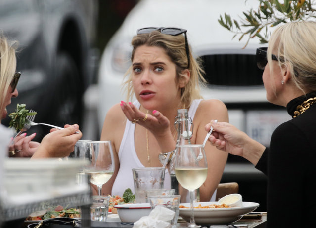 American actress Ashley Benson is spotted out for lunch with her mom in West Hollywood on May 10, 2021. The Pretty Little Liars star showed off her eclectic style wearing a midriff bearing crop top under a bulky NMB NY jacket paired with back trousers and black boots. The 31 year old  actress looked to be in great spirits as she sipped white wine and ate a salad. (Photo by TheImageDirect)
