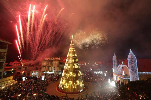 Fireworks are set off as a Christmas tree is illuminated in Dhour Shweir, Mount Lebanon, December 10, 2016. (Photo by Aziz Taher/Reuters)