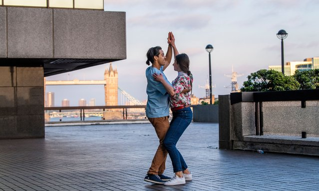 Luis Alberto and Marta practice their salsa dancing on an office walk way near London Bridge on June 1, 2021. (Photo by Jill Mead/The Guardian)