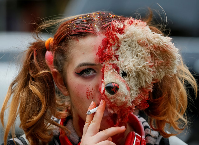 "A participant takes part in a ""Zombie Walk"" parade in Kiev, Ukraine on October 27, 2018. (Photo by Gleb Garanich/Reuters)"