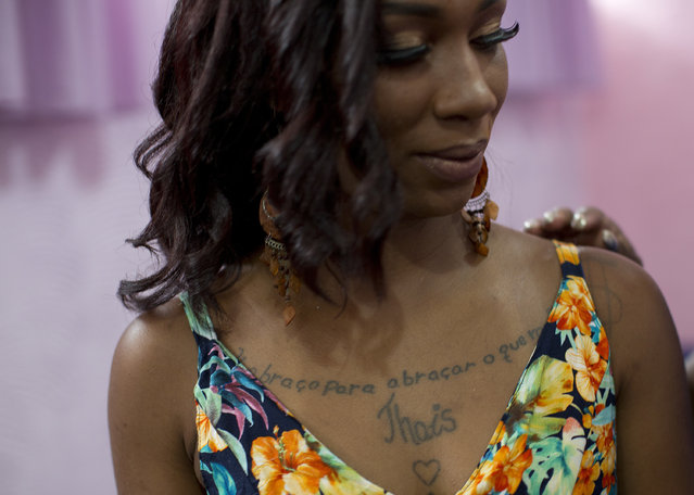 "An inmate, with a tattoo that reads in Portuguese, ""I embrace you, to embrace what I lack"", waits to compete in the 13th annual Miss Talavera Bruce beauty pageant at the penitentiary the pageant is named for, in Rio de Janeiro, Brazil, Tuesday, December 4, 2018. A group of women serving time at a prison in Rio de Janeiro swapped their uniforms for gowns on Tuesday to compete in the beauty pageant. (Photo by Silvia Izquierdo/AP Photo)"