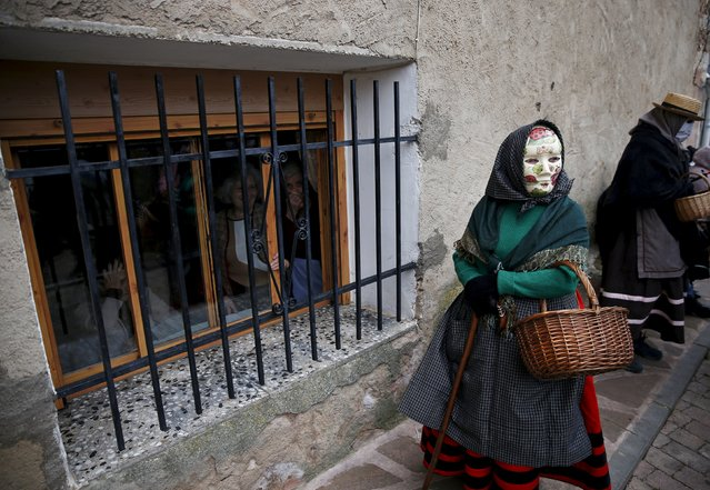 "A reveller dressed as a ""Mascaritas"" attends carnival celebrations in the village of Luzon, Spain, February 6, 2016. (Photo by Sergio Perez/Reuters)"