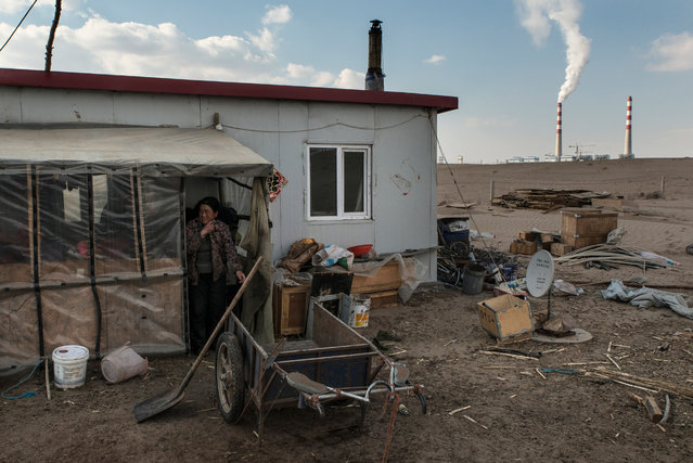 The home of a herder in front near the Datang plant. Nomadic pastoralists have lived on the grasslands of Inner Mongolia for thousands of years, but many are being pushed from their homes by mining and mineral industries. (Photo by Gilles Sabrie/The Washington Post)
