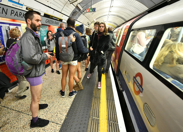 People on the Underground as they take part in the No Trousers Tube Ride, in London on January 13, 2019. (Photo by Dominic Lipinski/PA Images via Getty Images)