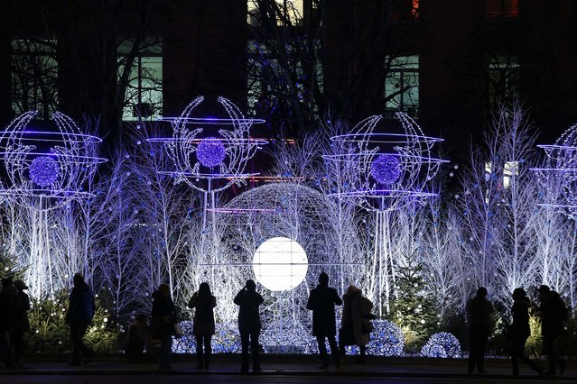 Christmas decorations light up the Champs Elysees in Paris. (Photo by Christophe Ena/Associated Press)
