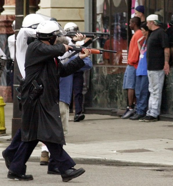 In this Tuesday, April 10, 2001, file photo, Cincinnati police point riot guns at demonstrators in Cincinnati. As the trial approaches for a white officer who fatally shot an unarmed black man, memories are vivid of 2001 race riots in Cincinnati. Police are beefing up security and say they're prepared for anything. Prospective jurors will be questioned Monday, Oct. 31, 2016, for Ray Tensing's trial on murder and voluntary manslaughter charges in the shooting of Sam DuBose after he was pulled over July 19, 2015, near the University of Cincinnati for a missing front license plate. (Photo by Tom Uhlman/AP Photo)