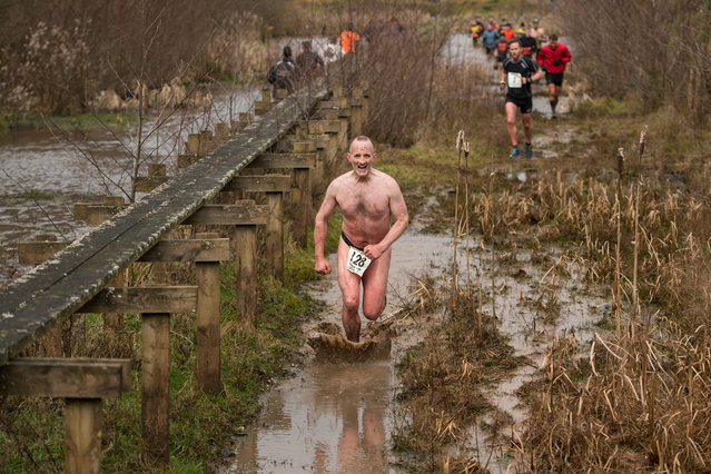 A competitor runs through muddy water as he takes part in the Tough Guy endurance event near Wolverhampton, central England, on January 27, 2019. (Photo by Oli Scarff/AFP Photo)