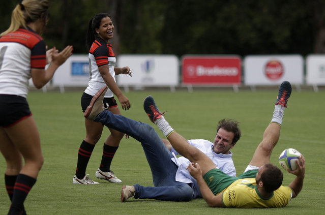 Rio de Janeiro's Mayor Eduardo Paes (C) plays with Rugby players during the inauguration of the Deodoro Stadium, which will host rugby sevens' Olympic debut and riding and combined sections of the modern pentathlon during the Rio 2016 Olympic Games in Rio de Janeiro, Brazil, March 2, 2016. (Photo by Ricardo Moraes/Reuters)