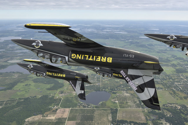 Three of the seven aircraft Breitling Jet Team fly their L-39C Albatros jets in formation and inverted over central Florida ahead of the start of their inaugural American Tour on Wednesday, April 22, 2015. The team, based in Dijon, France, representing the independent Swiss watch company Breitling, will be make their first public North American appearance at the SUN 'n FUN Fly-In & International Expo at Linder Airport in Lakeland Florida on Friday, April 24 and Saturday, April 25, 2015. (Photo by Katsuhiko Tokunaga/Breitling via AP Images)