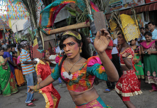 A Sri Lankan ethnic Tamil dancer performs during an annual Hindu temple procession in Colombo, Sri Lanka, Friday, April 24, 2015. (Photo by Eranga Jayawardena/AP Photo)