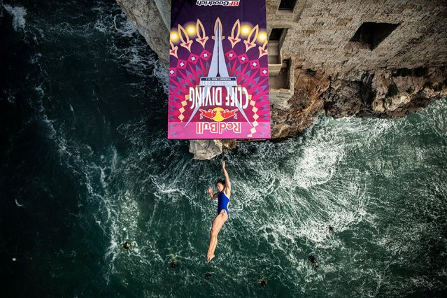 In this handout image provided by Red Bull, Meili Carpenter of the United States dives from the 21 metre platform during the final competition day of the fifth stop of the Red Bull Cliff Diving World Series on September 22, 2021 at Polignano a Mare, Italy. (Photo by Dean Treml/Red Bull via Getty Images)