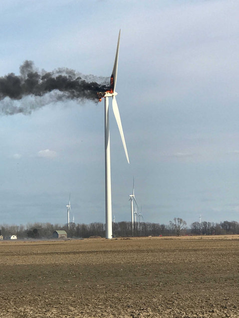 A fire burns at a wind turbine on Monday, April 1, 2019, near Elkton, Mich. The fire drew spectators who watched flaming debris fall to the ground, but no injuries were reported. Crews let the fire burn itself out. (Photo by Renee Willis/The Huron Daily Tribune via AP Photo)