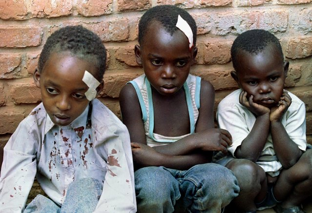 Rwandan orphans hide in a nearby house after their orphanage was hit by shelling May 28, 1994. (Photo by Corinne Dufka/Reuters)