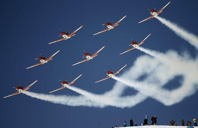 Members of the Swiss Air Force PC 7 team fly in formation over the Alpine Skiing World Cup finals in the mountain resort of St. Moritz, Switzerland March 20, 2016. (Photo by Arnd Wiegmann/Reuters)