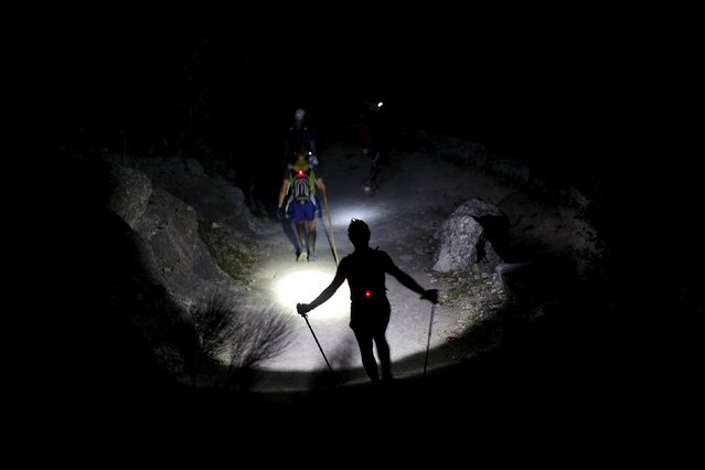 Runners use headlamps as they descend a mountain during the XVIII 101km international competition on the outskirts of Montejaque, southern Spain, early May 10, 2015. (Photo by Jon Nazca/Reuters)