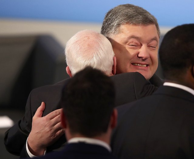 Ukraine President Petro Poroshenko hugs U.S. Senator John McCain at the 53rd Munich Security Conference in Munich, Germany, February 17, 2017. (Photo by Michael Dalder/Reuters)