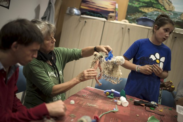 Participants in a workshop organised by Skeleton Sea make sculptures from waste collected from the sea at the Torre Madariaga Biodiversity Centre in Busturia, Spain, May 17, 2015. (Photo by Vincent West/Reuters)