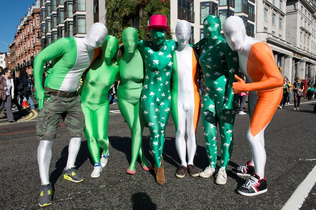 Revelers dressed in Irish themed body suits at the Mayor of London's St Patrick's Day celebration parade and festival in central London, on March 16, 2014. (Photo by Laura Lean/PA Wire)