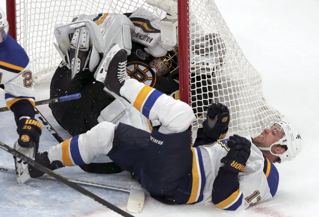 St. Louis Blues' Jaden Schwartz, front, ends up on his back and Boston Bruins goaltender Tuukka Rask, of Finland, ends up in the net during the second period in Game 2 of the NHL hockey Stanley Cup Final, Wednesday, May 29, 2019, in Boston. (Photo by Charles Krupa/AP Photo)