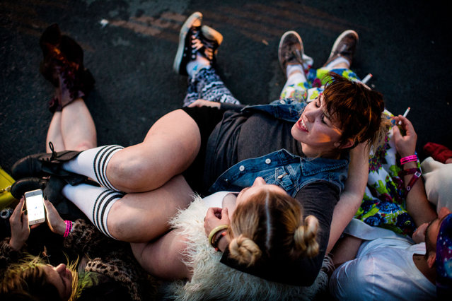 In this Friday, May 22, 2015 photo, fans lie on the ground together on the first of four days of the annual Sasquatch music festival at The Gorge Amphitheatre in George, Wash. (Photo by Jordan Stead/Seattlepi.com via AP Photo)