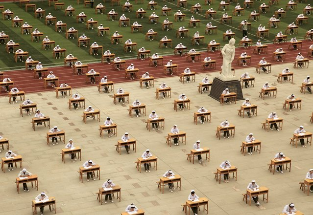 Hundreds of students of the school of nursing take part in an open-air examination at a playground of an vocational college in Baoji, Shaanxi province, China, May 25, 2015. (Photo by Reuters/Stringer)